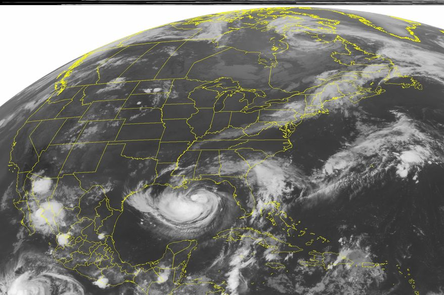 A National Oceanic and Atmospheric Administration satellite image taken on Tuesday, Aug. 28, 2012, at 1:45 a.m. EDT shows a swirl of clouds in the Gulf of Mexico associated with Tropical Storm Isaac as it moves slowly toward the central Gulf Coast. Landfall is expected later Tuesday or early Wednesday in Louisiana. (AP Photo/Weather Underground)