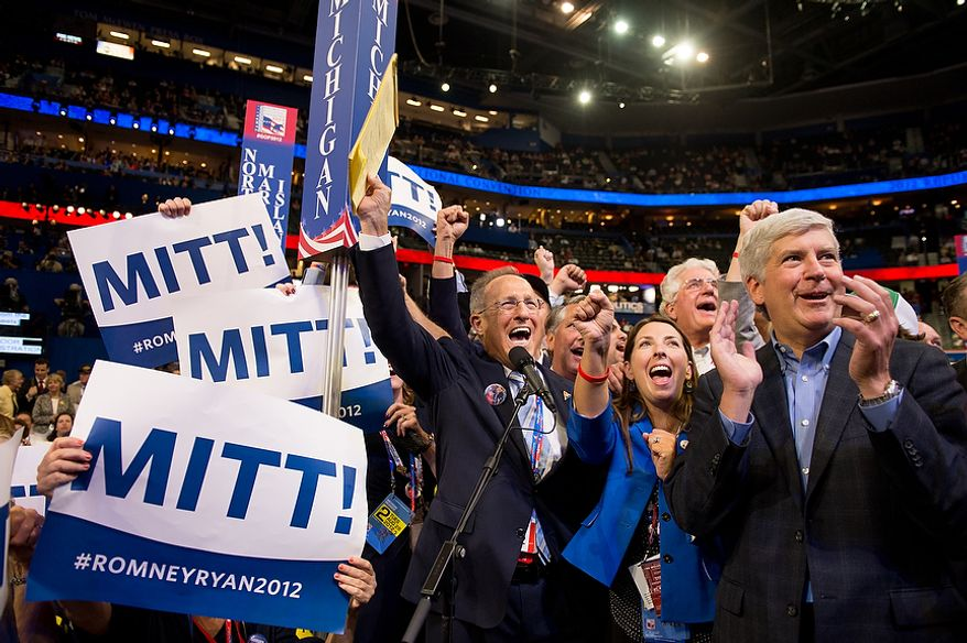 Michigan delegates cheer as Mitt Romney's brother Scott, center, announces the delegate votes for Romney's home state at the Republican National Convention, Tampa, Fla., Tuesday, August 28, 2012. (Andrew Harnik/The Washington Times)