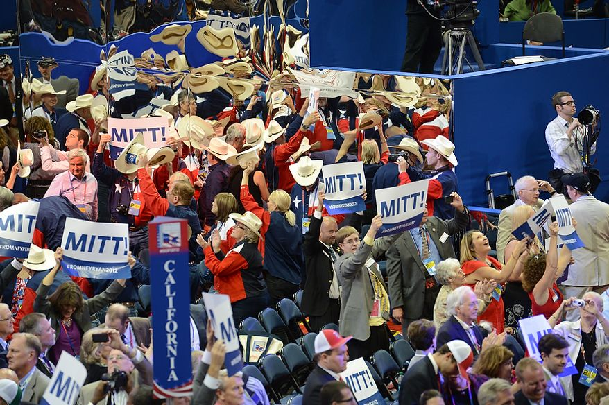Mitt Romney supporters cheer at the conclusion of the Roll Call for Nomination which gave Romney the presidential nomination during the Republican National Convention at the Tampa Bay Times Forum in Tampa, Fla. on Tuesday, August 28, 2012. (Rod Lamkey, Jr./ The Washington Times)