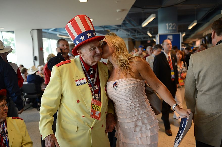 Col. Oscar C. Poole gets a kiss from Julie Craig at the Republican National Convention at the Tampa Bay Times Forum in Tampa, Fla. on Tuesday, August 28, 2012. (Rod Lamkey, Jr./ The Washington Times)