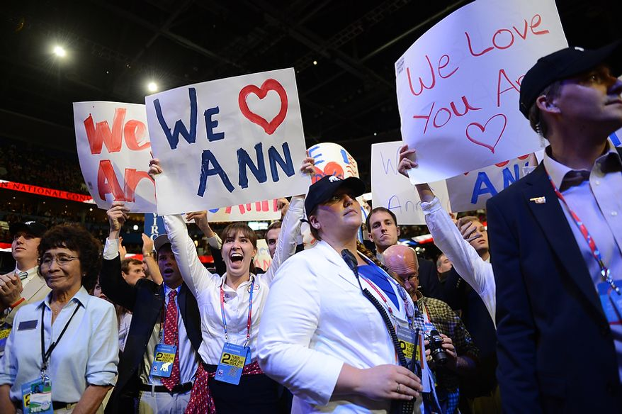 Delegates cheer as Ann Romney, is greeted by her husband, Republican presidential candidate, Mitt Romney, after she addressed the Republican National Convention at the Tampa Bay Times Forum in Tampa, Fla. on Tuesday, August 28, 2012. (Andrew Harnik/ The Washington Times)