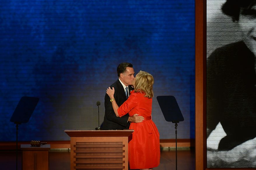 Ann Romney, is greeted by her husband, Republican presidential candidate, Mitt Romney, after she addressed the Republican National Convention at the Tampa Bay Times Forum in Tampa, Fla. on Tuesday, August 28, 2012. (Rod Lamkey, Jr./ The Washington Times)