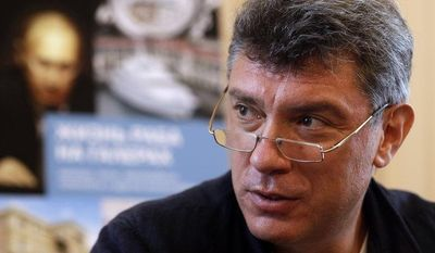 Opposition leader Boris Nemtsov speaks about his new book on the wealth of Russian President Vladimir Putin during a news conference in Moscow on Tuesday, Aug. 28, 2012. (AP Photo/Sergey Ponomarev)