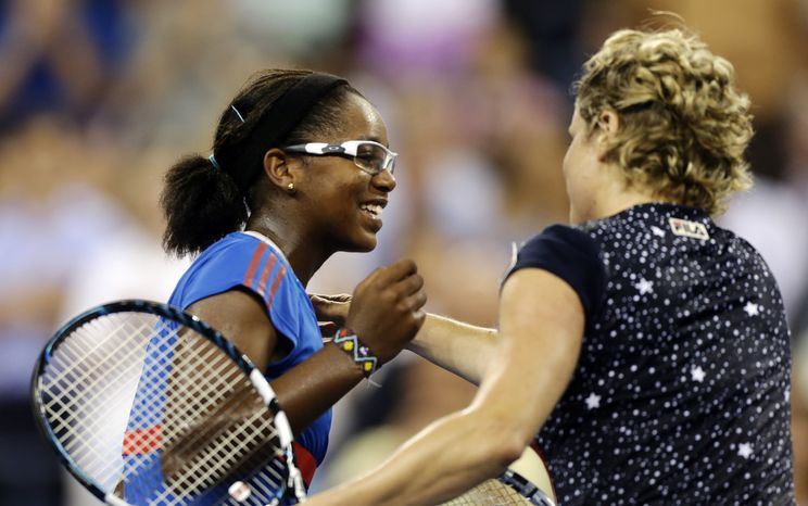 Victoria Duval, left, congratulates Kim Clijsters, of Belgium, on her 6-3, 6-1 win in the first round of play at the U.S. Open tennis tournament, Monday, Aug. 27, 2012, in New York. (AP Photo/Charles Krupa)