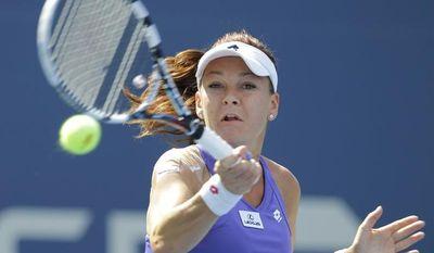 Agnieszka Radwanska, of Poland, returns a shot to Nina Bratchikova, of Russia,  at the 2012 US Open tennis tournament, Tuesday, Aug. 28, 2012, in New York. (AP Photo/Kathy Willens)