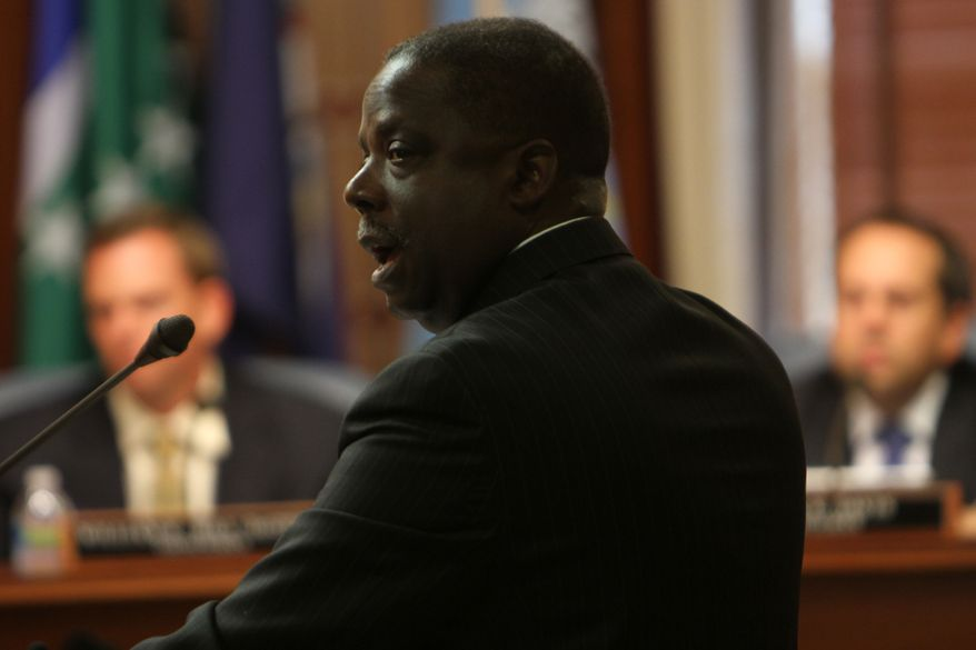 Warren Harris, Director of Economic Development authority, briefs the Virginia Beach City Council in Virginia Beach, Va., on Tuesday, Aug. 28, 2012, afternoon on the benefits to the region to bringing a professional sports team to town. (AP Photo/The Virginian-Pilot, Stephen M. Katz)