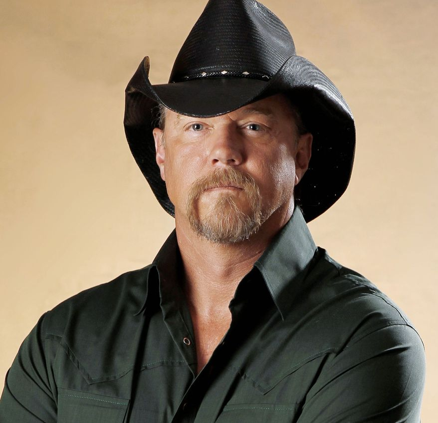 Country singer Trace Adkins and entertainer Kristin Chenoweth are returning as hosts for the third edition of the American Country Awards. The pair hosted the show together last year. (Associated Press)