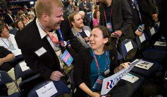 Massachusetts Delegate Elizabeth Mahoney, center, talks with delegate Brandon Navom of Lowell, Mass., at the Republican National Convention, Tampa, Fla., Wednesday, August 29, 2012. (Andrew Harnik/The Washington Times)