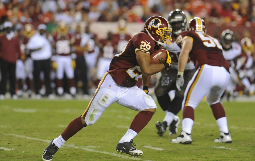 Washington Redskins running back Roy Helu (29) runs with the ball during the first half of an NFL preseason football game with the Tampa Bay Buccaneers Wednesday, Aug. 29, 2012, in Landover, Md. (AP Photo/Richard Lipski)