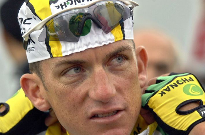 """FILE - In this July 1, 2004 file photo, cyclist Tyler Hamilton, of the United States, speaks prior to training with his teammates in Liege, Belgium. Hamilton's tell-all book about Lance Armstrong and doping in cycling will be released two weeks earlier than originally planned.  """"The Secret Race: Inside the Hidden World of the Tour de France: Doping, Cover-ups, and Winning at All Costs,"""" is now scheduled for release Sept. 5.  (AP Photo/Peter Dejong, File)"""
