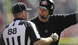 FILE - This Aug. 26, 2012 file photo shows San Francisco 49ers head coach Jim Harbaugh, right, arguing with a replacement official during the second quarter of an NFL preseason football game against the Denver Broncos,  in Denver. The NFL will open the regular season with replacement officials. League executive Ray Anderson has told the 32 teams that with negotiations remaining at a standstill between the NFL and the officials' union. The replacements will be on the field beginning next Wednesday night, Sept. 5, 2012 when the Cowboys visit the Giants to open the season. (AP Photo/Joe Mahoney, File)