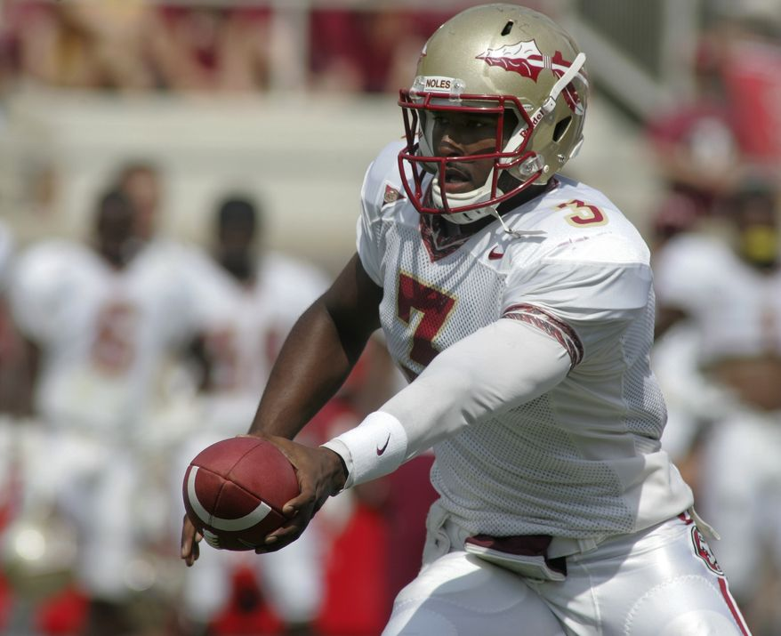 Florida State quarterback EJ Manuel (3) hands off in the first half of Florida State's NCAA college football Spring Game on Saturday, April 14, 2012, in Tallahassee, Fla. (AP Photo/Phil Sears)