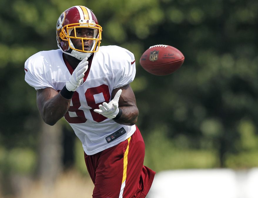 Washington Redskins wide receiver Pierre Garcon prepares to catch the ball at the team's NFL football training camp practice at Redskins Park, Monday, Aug. 13, 2012, in Ashburn, Va. (AP Photo/Alex Brandon)