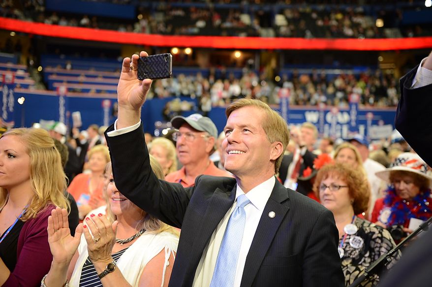Virginia Governor Bob McDonnell takes a picture of his daughter Jeanine McDonnell, who served as a U.S. Army Signal Corps officer in Iraq, as she introduced Sen. John McCain, R-Ariz., at the Republican National Convention at the Tampa Bay Times Forum in Tampa, Fla. on Wednesday, August 29, 2012. (Andrew Harnik/ The Washington Times)