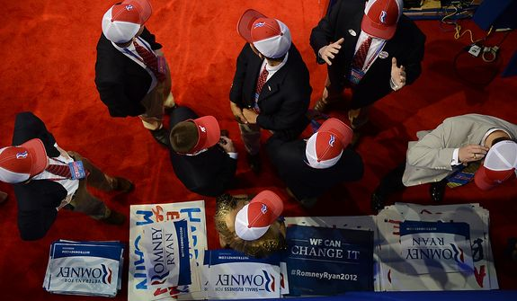 RNC pages prepare to hand out Romney signs at the Republican National Convention at the Tampa Bay Times Forum in Tampa, Fla. on Wednesday, August 29, 2012. (Andrew Harnik/ The Washington Times)