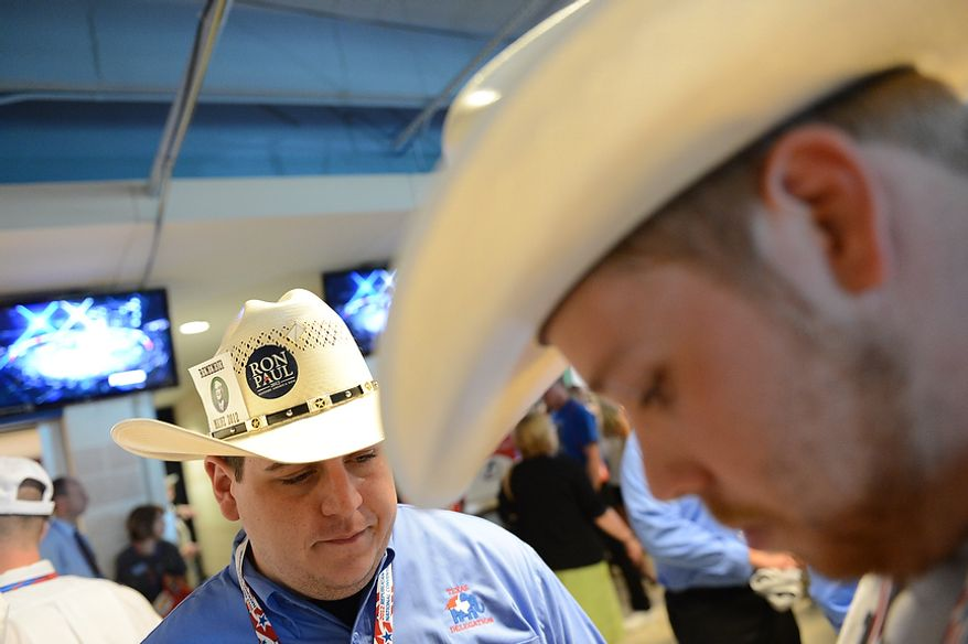 Ron Paul supporters, Harrison Whitaker, 24, of Ft. Worth, Tex., left and Colin Denney, 26, of Dallas, Tex., await the speech of Rand Paul at the Republican National Convention at the Tampa Bay Times Forum in Tampa, Fla. on Wednesday, August 29, 2012. (Rod Lamkey, Jr./ The Washington Times)