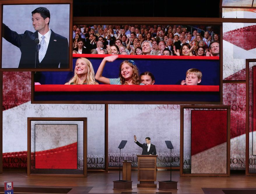 Republican vice presidential nominee, Rep. Paul Ryan waves toward his family seen on the television monitor during the Republican National Convention in Tampa, Fla., on Wednesday, Aug. 29, 2012. (AP Photo/J. Scott Applewhite)