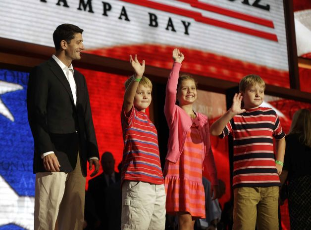 Republican vice presidential nominee, Rep. Paul Ryan of Wisconsin walks across the stage with sons Sam, left, Charlie, right, and daughter Liza during a podium sound check at the Republican National Convention in Tampa, Fla., on Wednesday, Aug. 29, 2012. (AP Photo/Charles Dharapak)