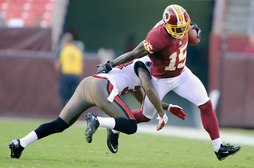 Washington Redskins wide receiver Josh Morgan (15) turns upfield against Tampa Bay Buccaneers cornerback Keith Tandy (37) during a first quarter reception at FedEx Field. (Preston Keres/Special to The Washington Times)
