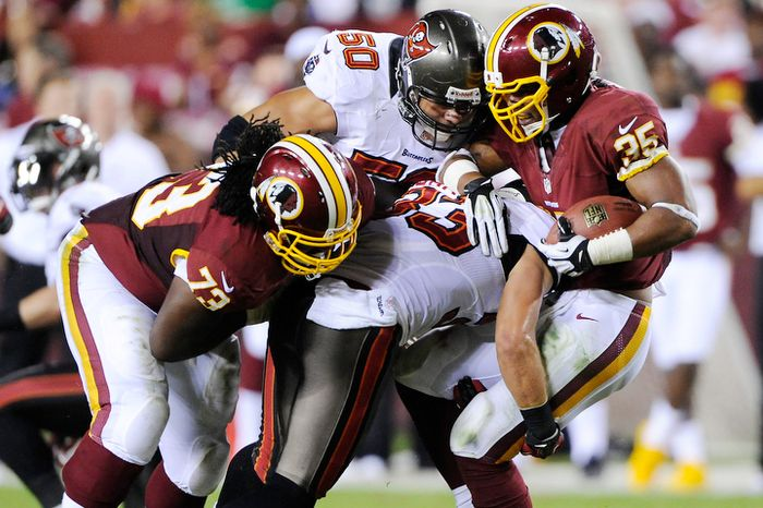 Washington Redskins guard Adam Gettis (73) blocks for running back Evan Royster (35) during a second quarter run. (Preston Keres/Special to The Washington Times)