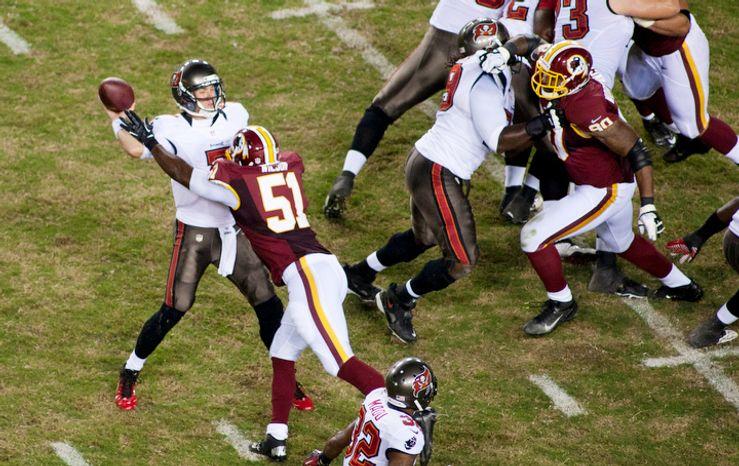 Washington Redskins linebacker Chris Wilson (51) rushes Tampa Bay Buccaneers quarterback Brett Ratliff (7) in the first half of the Tampa Bay Buccaneers at Washington Redskins preseason football game. (Craig Bisacre/The Washington Times)