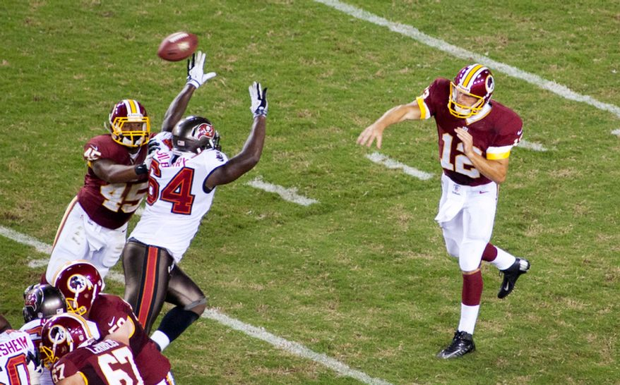 Washington Redskins quarterback Kirk Cousins (12) passes down field in the first half of the Tampa Bay Buccaneers at Washington Redskins preseason football game. (Craig Bisacre/The Washington Times)