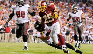 Washington Redskins running back Roy Helu (29) runs through Tampa Bay Buccaneers linebacker Jacob Cutrera (51) for a 6-yard touchdown run in the third quarter. (Preston Keres/Special to The Washington Times)