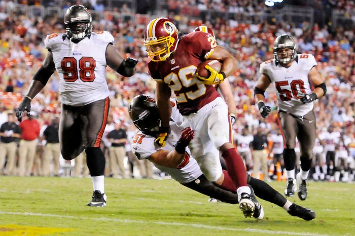 Washington Redskins running back Roy Helu (29) runs through Tampa Bay Buccaneers linebacker Jacob Cutrera (51) for a 6-yard touchdown run in the third quarter. (Preston Keres/Special to The Washington Times)