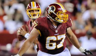 ** FILE ** Washington Redskins guard Josh LeRibeus (67) blocks for quarterback Jonathan Crompton during fourth-quarter action. (Preston Keres/Special to The Washington Times)