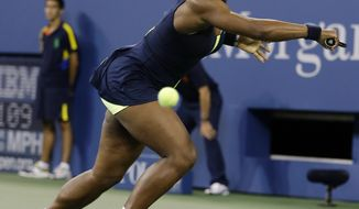 Serena Williams returns a shot to Coco Vandeweghe during a match at the U.S. Open tennis tournament, Tuesday, Aug. 28, 2012, in New York. Williams won 6-1, 6-1. (AP Photo/Darron Cummings)
