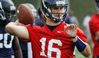 FILE - In this Aug. 6, 2012, file photo, Virginia quarterback Michael Rocco (16) looks to throw during NCAA college football practice in Charlottesville, Va. Head coach Mike London announced on Monday, Aug. 27, that Rocco has been named the starting quarterback for Saturday's game against Richmond. (AP Photo/Steve Helber, File)