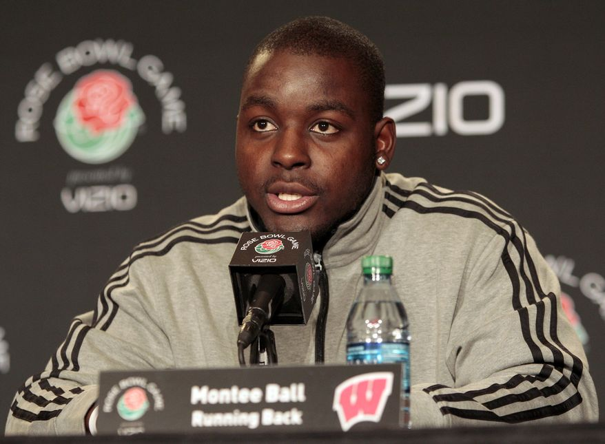 FILE - In this Dec. 28, 2011, file photo, Wisconsin running back Montee Ball speaks at a news conference in Los Angeles for the Rose Bowl NCAA college football game. Five men attacked the star running back near campus early Wednesday morning, Aug.1 , 2012,  inflicting head injuries serious enough to send him to the hospital, authorities said. Ball, a Heisman Trophy finalist last season as a junior, was taken to a hospital with head injuries, police said. (AP Photo/Jason Redmond, File)