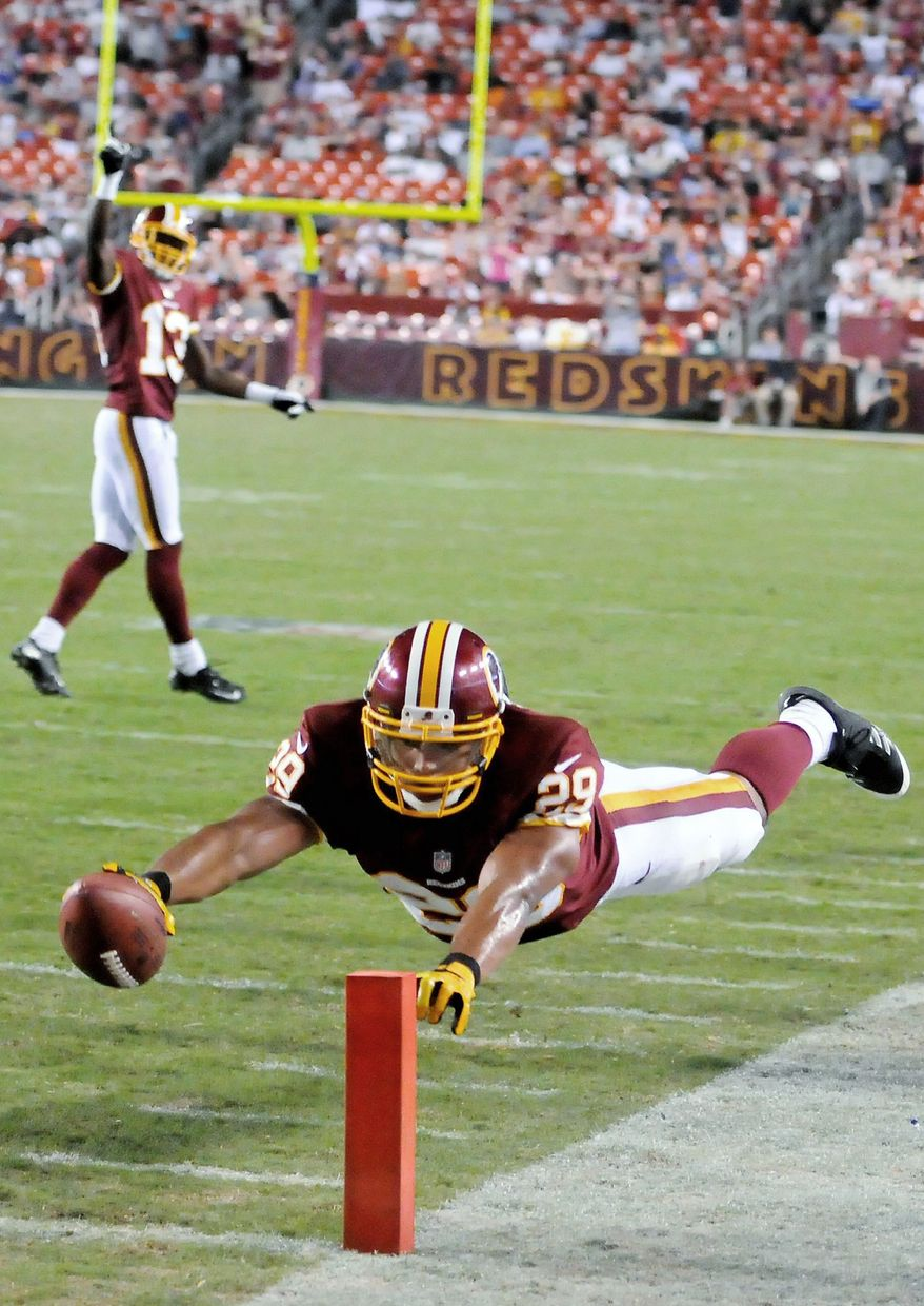 Running back Roy Helu Jr. dives to finish a 15-yard touchdown run Wednesday against Tampa Bay. Helu rushed 15 times for 90 yards and two TDs. (Preston Keres/Special to The Washington Times)