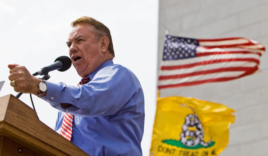 Former Wisconsin Gov. Tommy Thompson addressing a tea party rally in Madison in this 2010 file photo.
