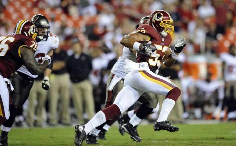 ** FILE ** Washington Redskins linebacker Bryan Kehl (53) runs with his interception during the second half of an NFL preseason football game with the Tampa Bay Buccaneers Wednesday, Aug. 29, 2012, in Landover, Md. (AP Photo/Nick Wass)