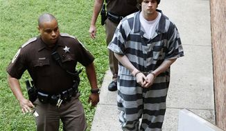 Former Virginia lacrosse player and convicted murderer George Huguely V is led to court for his sentencing in Charlottesville, Va., Thursday, Aug. 30, 2012. Huguely was sentenced to 23 years in prison for the alcohol-fueled beating death of his ex-girlfriend in 2010. (AP Photo/Steve Helber)