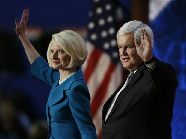Former House Speaker Newt Gingrich and his wife Callista wave after speaking to delegates during the Republican National Convention in Tampa, Fla., on Thursday, Aug. 30, 2012. (AP Photo/Lynne Sladky)