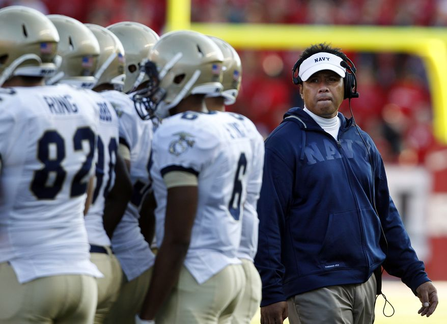 FILE - In this Saturday, Oct. 15, 2011 file photo, Navy head coach Ken Niumatalolo, right, stands with his players during the second half of an NCAA college football game against Rutgers in Piscataway, N.J. Rutgers won 21-20. For the first time since 2003, the Midshipmen are coming off a losing season. After going 5-7 and having their run of eight straight bowl bids end, the Midshipmen enter the 2012 season with a sense of urgency. (AP Photo/Mel Evans, File)