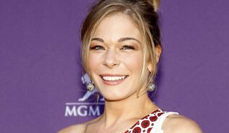 Country singer LeAnn Rimes arrives at the 47th annual Academy of Country Music Awards in Las Vegas on Monday, April 1, 2012. (AP Photo/Isaac Brekken)