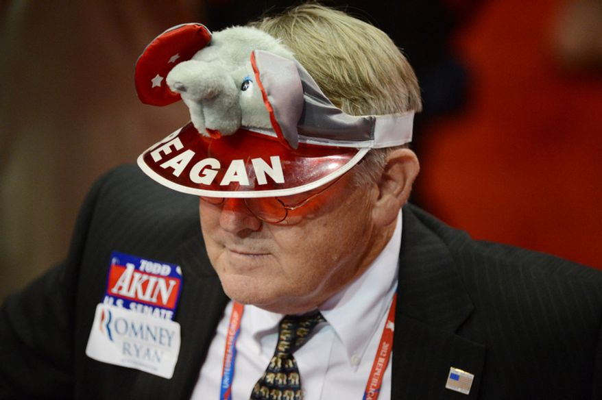 A delegate wears a Reagan visor, and Romney and Akin stickers at the Republican National Convention. (Andrew Harnik/ The Washington Times)