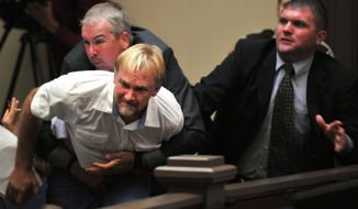 Wesley Thomas, stepfather of Tiffany York, is tackled by courtroom security during a hearing for Sgt. Anthony Peden in Long County Superior Court on Thursday, Aug. 30, 2012, in Ludowici, Ga. (AP Photo/Stephen Morton)