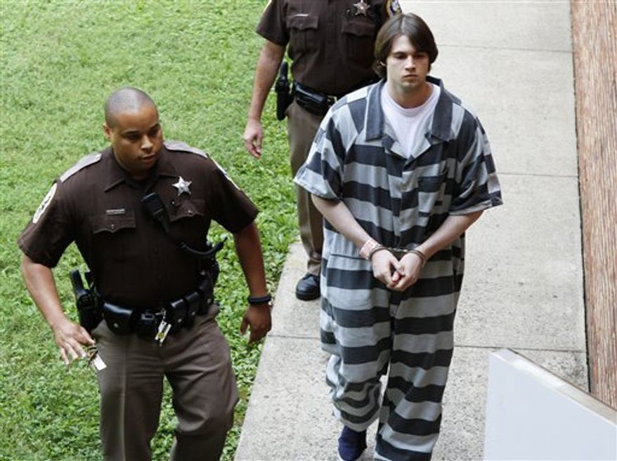 Former Virginia lacrosse player and convicted murderer George Huguely V is led to court for his sentencing in Charlottesville, Va., Thursday, Aug. 30, 2012. Huguely was sentenced to 26 years in prison for the alcohol-fueled beating death of his ex-girlfriend in 2010.  (AP Photo/Steve Helber)
