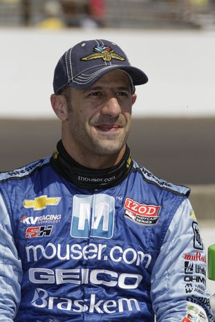 IndyCar driver Tony Kanaan, of Brazil, is shown after he qualified for the Indianapolis 500 auto race at the Indianapolis Motor Speedway in Indianapolis, Saturday, May 19, 2012. (AP Photo/Dave Parker)