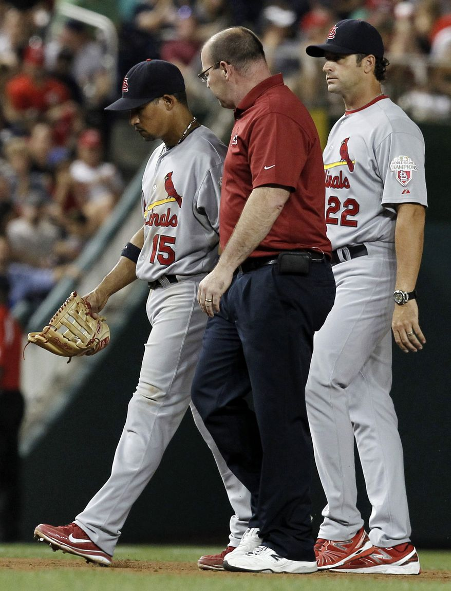St. Louis Cardinals shortstop Rafael Furcal, left, leaves the game with trainer Greg Hauck, and manager Mike Matheny during the sixth inning of a baseball game against the Washington Nationals at Nationals Park Thursday, Aug. 30, 2012, in Washington. The Nationals won 8-1. (AP Photo/Alex Brandon)