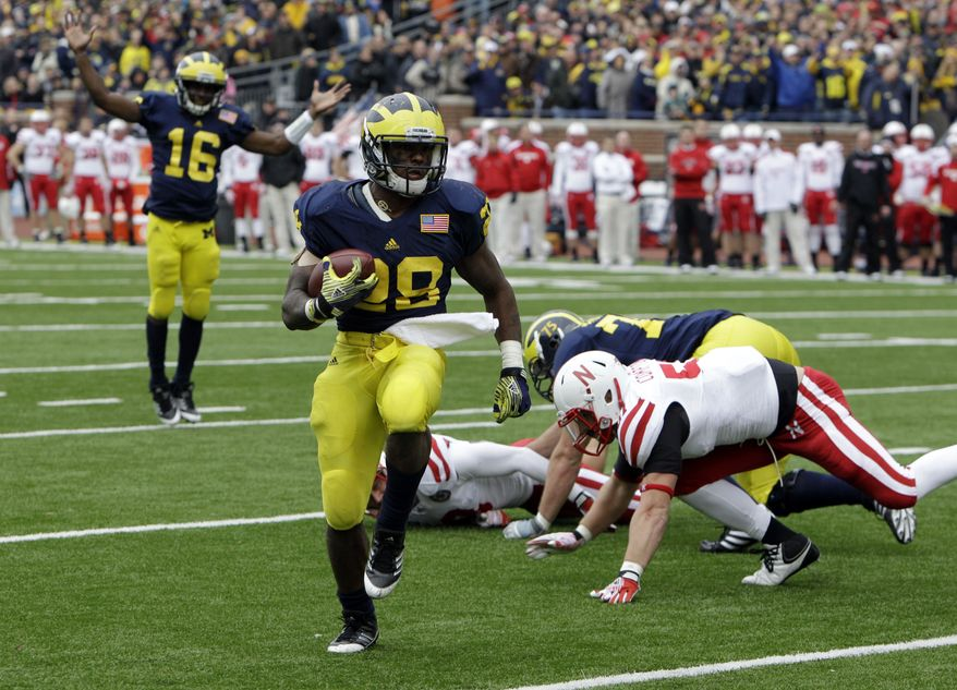 FILE - In this Nov. 19, 2011, file photo, Michigan running back Fitzgerald Toussaint (28) scores a touchdown during the third quarter of a college football game against Nebraska in Ann Arbor, Mich. Toussaint is scheduled to face a DUI charge, but coach Brady Hoke insists the outcome in court won't affect his decision about playing him or not against Alabama. (AP Photo/Carlos Osorio, File)