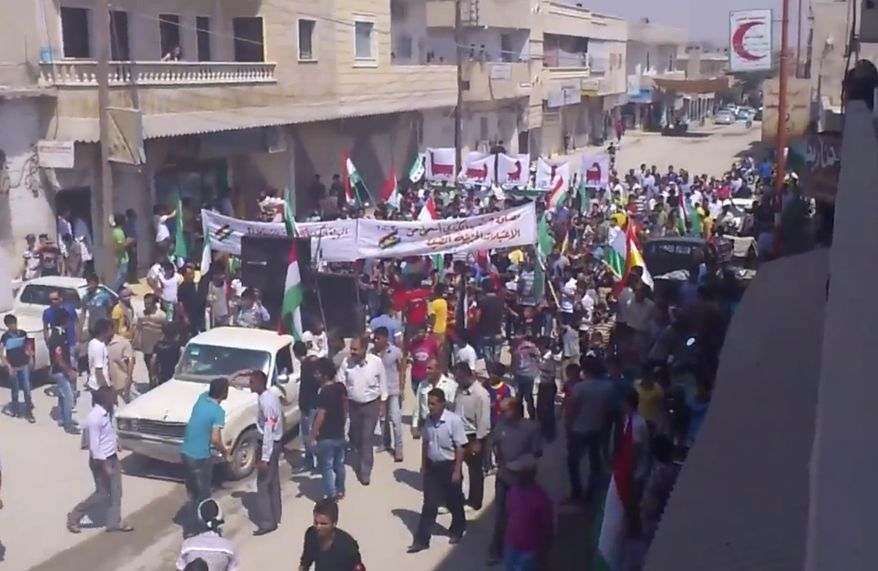 This image made from video provided by Shaam News Network and accessed via AP video purports to show a demonstration in Aleppo, Syria, on Aug. 31, 2012. Syrian rebels have begun a major operation in the Aleppo region, aiming to strike at security compounds and bases around Syria's largest city, activists said. (Associated Press/Shaam News Network via AP video)