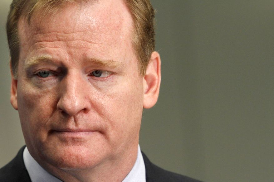 **FILE** NFL Commissioner Roger Goodell answers questions from the media after speaking about concussions at the Congress of Neurological Surgeons in Washington. (Associated Press)