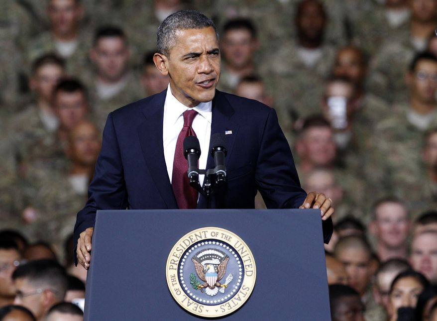 President Barack Obama speaks to troops, service-members and military families at the 1st Aviation Support Battalion Hangar at Fort Bliss ,Friday, Aug. 31, 2012, in El Paso, Texas. (AP Photo/Tony Gutierrez)