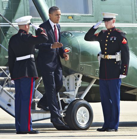 President Obama disembarks Marine One on Aug. 31, 2012, on his way to switch to Air Force One at Andrews Air Force Base, Md., for a trip to Fort Bliss in Texas. (Associated Press)