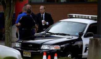 Middlesex County prosecutor Bruce Kaplan (right) arrives at the scene of a shooting Aug. 31, 2012, at a Pathmark grocery store in Old Bridge, N.J. At least three people died in the shooting. (Associated Press)